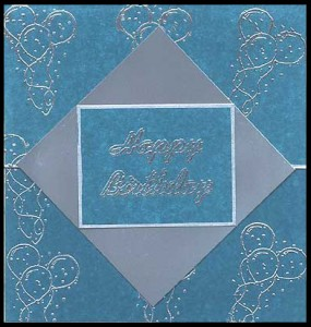 This birthday card is made using only silver and blue.