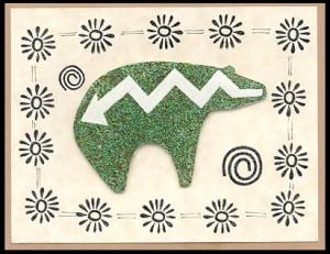 Zuni Bear is embossed. Border is three accent stamps.