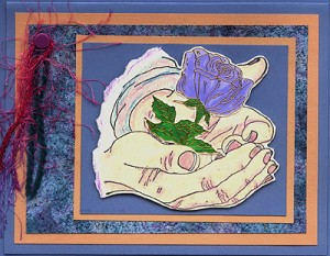 This card was created by stamping Cupped Hands and Rose with a Stem.