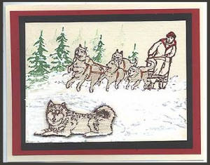 The focus of this card is the dog sled and the Husky dog.