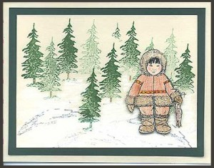 The Eskimo Child with a fish is the focus point of this card.