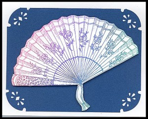 This card is created by stamping the Rose Fan, Lg. using a rainbow pad.
